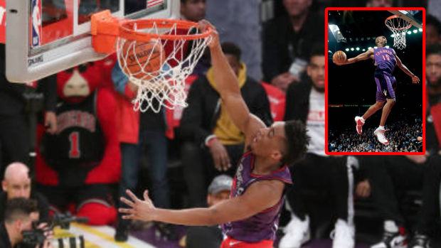 Donovan Mitchell wins slam dunk contest with Vince Carter tribute dunk in  throwback Raps  jersey - Article - Bardown 246cd846f