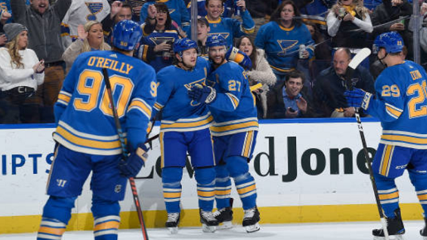 St. Louis Blues players celebrate a goal.