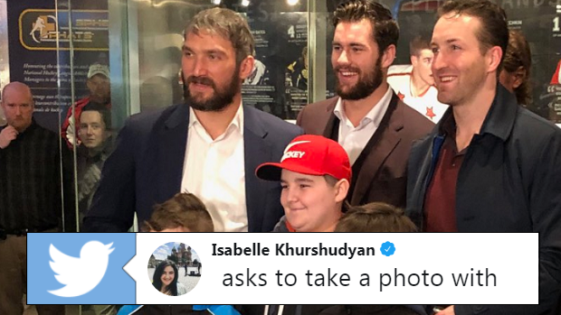 Washington Capitals players pose for a photo with young fans at the Hockey Hall of Fame.