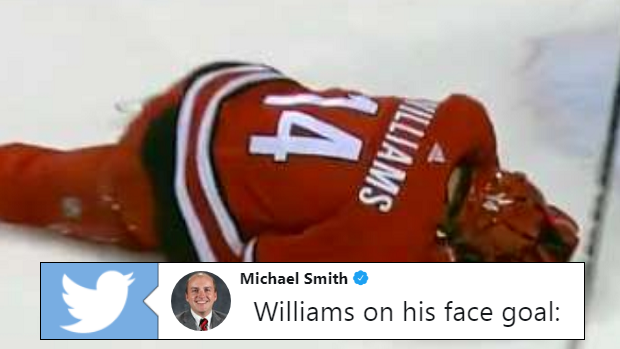 Justin Williams lays on the ice after taking a shot to the face.