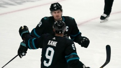 Logan Couture (39) celebrates with Evander Kane (9)