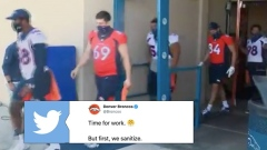 Denver Broncos players walk through sanitizing spray