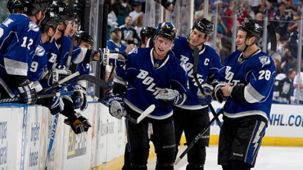 Steven Stamkos celebrates with teammates after recording his 50th goal during the 2009-10 season.