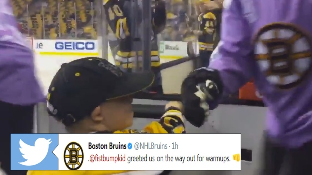quality design 0ba7f f018c The Bruins' fist bump kid welcomed the team to the ice for ...