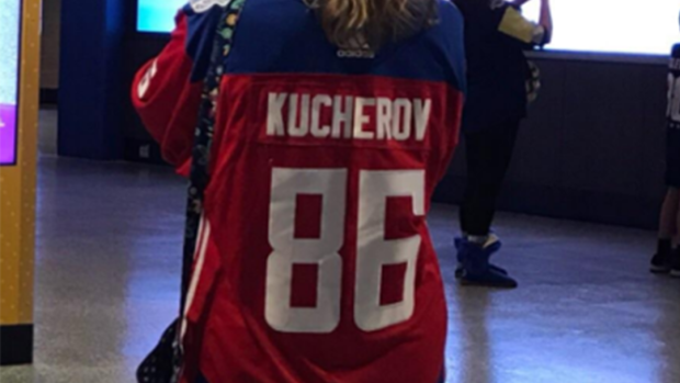 the best attitude f09e6 a2bb9 A fan wore a Nikita Kucherov Czech Republic jersey over all ...
